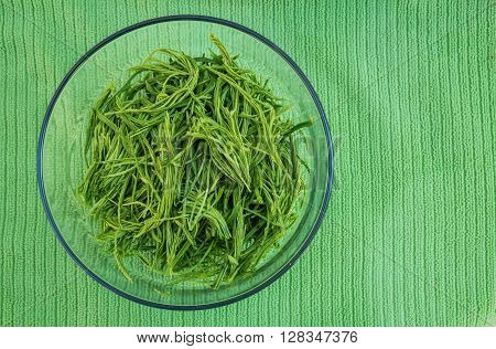 Top view Acacia pennata in bowl, preparation for cooking