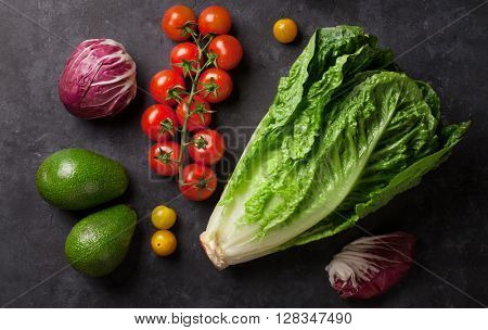 Fresh vegetables over stone table. Top view
