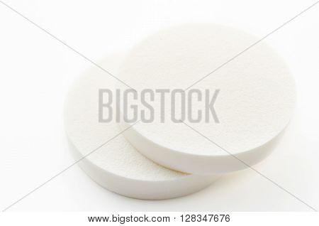 The face sponge powder on white background.