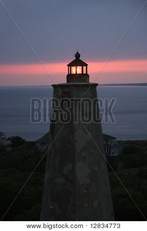 Old Baldy lighthouse at dusk on Bald Head Island, North Carolina.