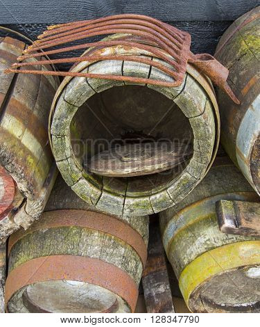 old rotten wooden barrels on green grass