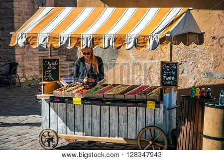 Blonde Woman Near Small Market With Treats