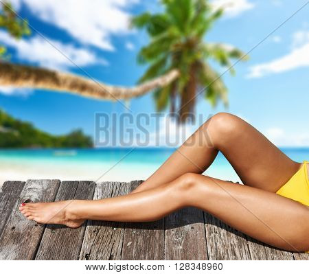 Woman relaxing at beach jetty