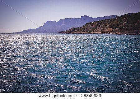 sea and coastline with mountains with filter