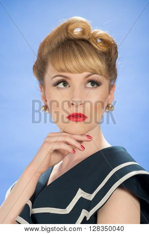 Glamorous woman with victory roll curls hairstyle