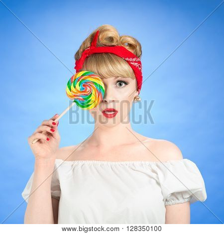 Pin up girl with candy lollipop