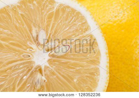 piece of yellow fruit of citrus close up.