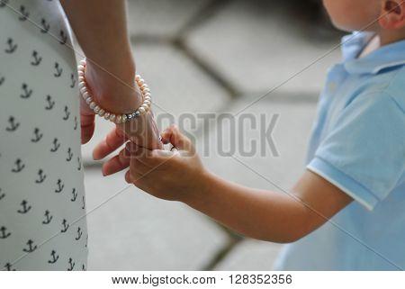 little boy gently took her mother's hand