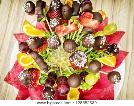 Tasty fruit bouquet with chocolate frosting. Gift for you. Special gift. Mother's day. Vibrant colors.