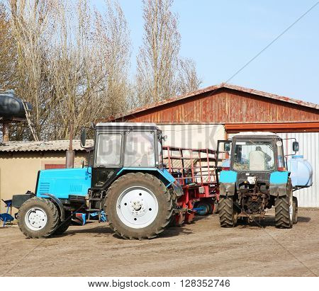 Tractors on a farm.