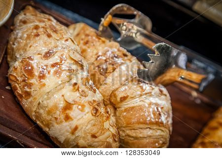 Almond croissants on a self service breakfast counter in a hotel restaurant