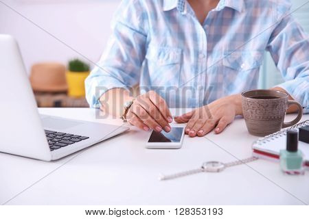 Blogging concept. Woman using her phone.