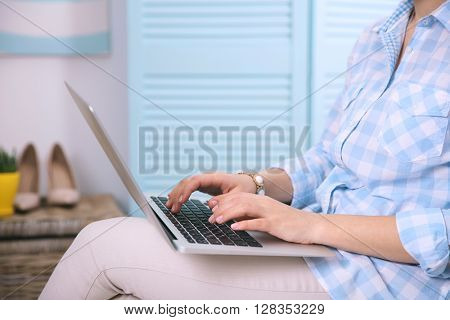 Blogging concept. Woman using her laptop.