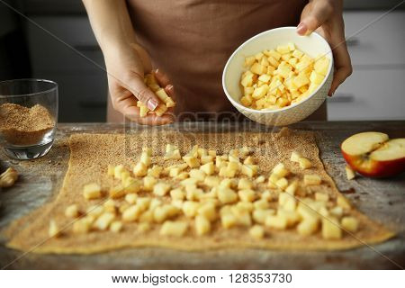 Woman cooking apple pie