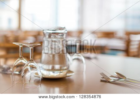 Jag of tap water and glasses on the table before wedding dinner reception