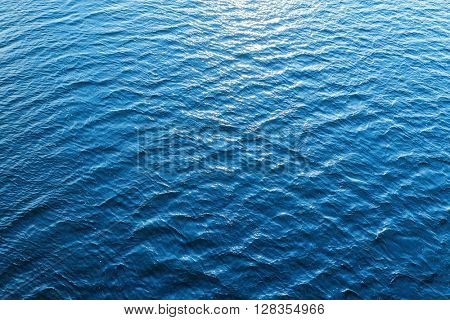 blue water as background with sun reflections