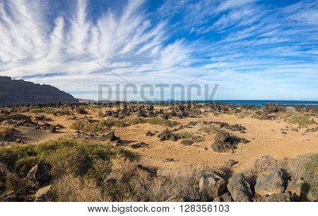 The coast of Atlantic ocean near town Orzola on Lanzarote Canary islands Spain