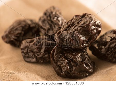 heap of pitted prunes in linen cloth