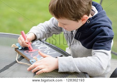 Little Boy Child Drawing A Love Declaration
