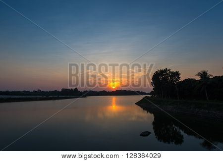 Sunset landscape with twilight at the lake