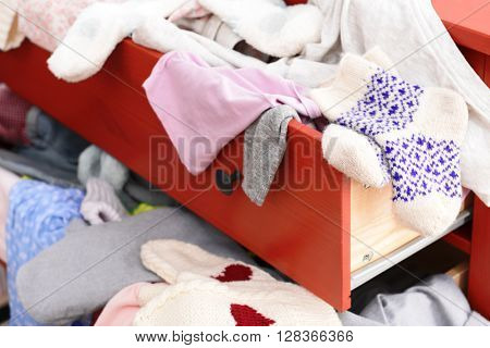 Pile of clothes in open drawer, close up