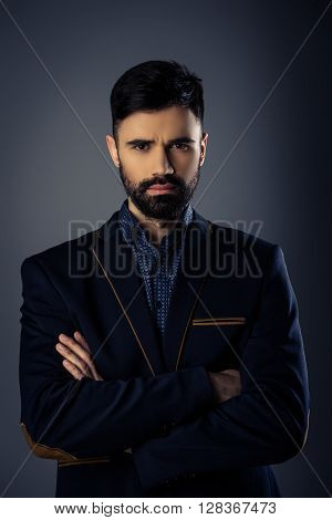 Sexy Serious Man In Suit Posing With Crossed Hands