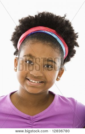 African American girl wearing headband smiling at viewer.