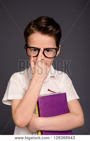 Smart Little School Boy In Glasses Holding Books
