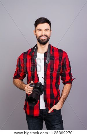 Handsome Smiling Photographer With Camera On Gray Background