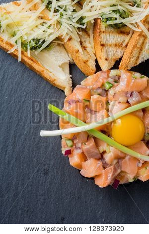 fish tartare with quail egg and fried bread