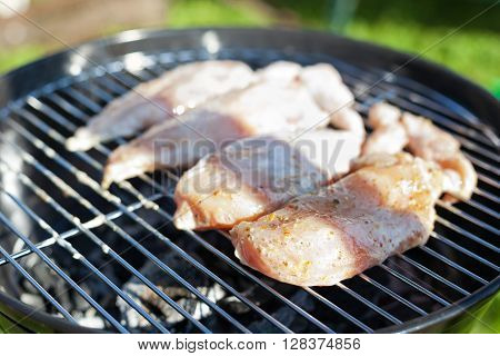 Raw Chicken Fillet Breast Cooking On Barbeque Grid