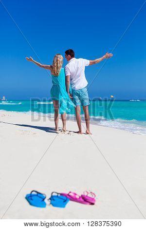 Beach Flip-flops On Romantic Couple Background