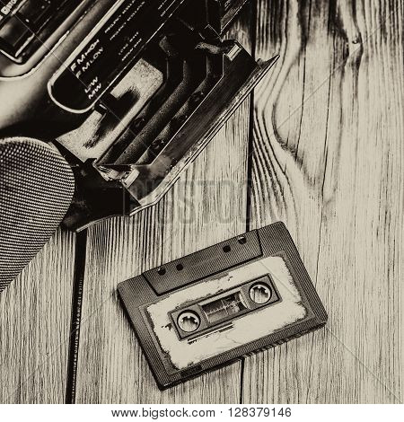 old cassette tape and player on the old wooden background