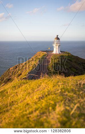 Cape Reinga on the North Island of New Zealand. Pacific Ocean hitting the Tasman Sea.
