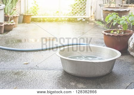 old zinc bucket of water standing on floor