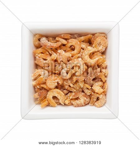 Dried shrimps in a square bowl isolated on white background