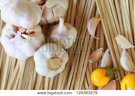 Shallot and garlic on the wood background.