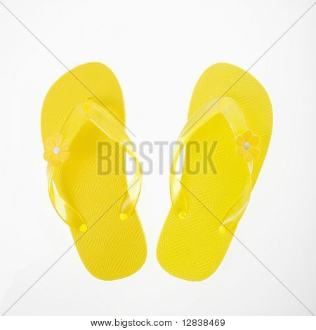 Yellow plastic thong sandals.