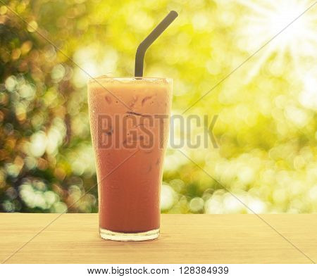 Ice milk tea on wood with spring morning light background Vintage style