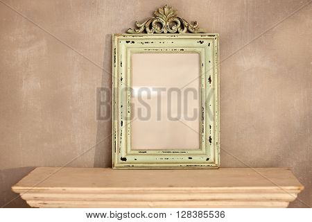 Retro style frame in front of painted wall.
