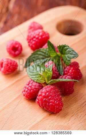 raspberry on wood background selective focus