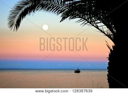Sunset and Moonrise in Zakynthos island Greece