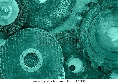 Closeup various abrasive discs hacksaw and circular saw blades pattern. Toned.