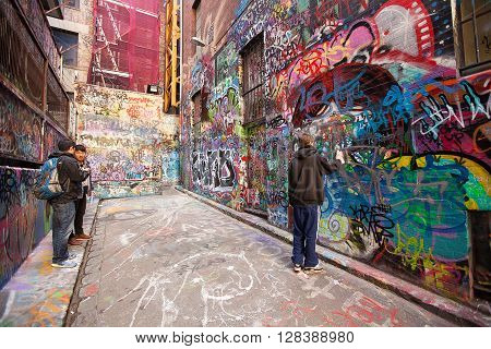 Melbourne Australia-September 13 2012. Graffiti artist in action in Hosier Lane a much celebrated landmark mainly due to its sophisticated Urban art in the centre of Melbourne Victoria australia