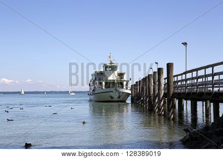 Steamship at the pier at isle Chiemsee in Bavaria Germany