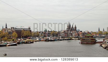 City-scape: view on part of the City of Amsterdam at 'Boven IJ' water, east of Central Station Amsterdam, Netherlands