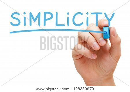 Hand writing Simplicity with blue marker on transparent wipe board isolated on white.