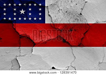 flag of Amazonas painted on cracked wall
