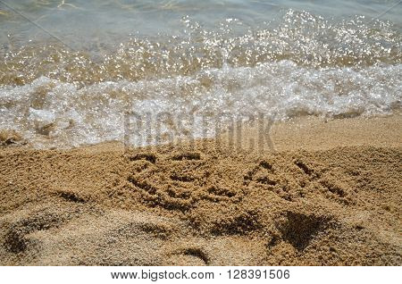Word Relax In Sand