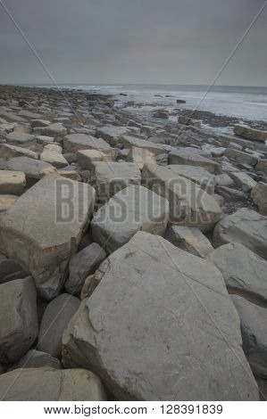 A close up of rocks at Kimmeridge Bay, Dorset, next to the sea